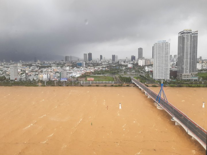 Waves and debris  in the Han River as Typhoon Molave looms over Danang City
